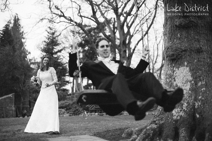 Groom on swing in the Lake District.