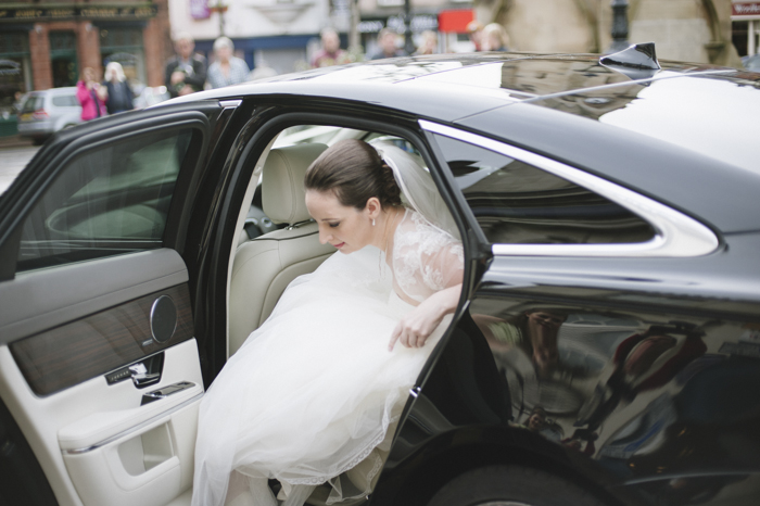 Bride getting out of car in Penrith